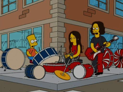Dave Grohl tiene flores para Meg White